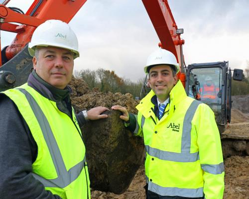 Abel Homes production manager Robert Loudoun left and managing director Paul LeGrice cut the first sod at Gressenhall sm