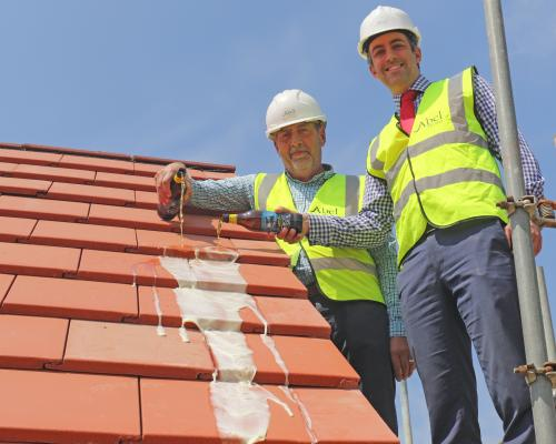 Alan Read left and Paul LeGrice top out the showhome at Hares Green in Watton