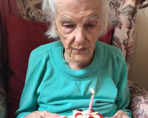 Annie Nicholls celebrates her 103rd birthday with a cake at Thomas Tawell House in Norwich