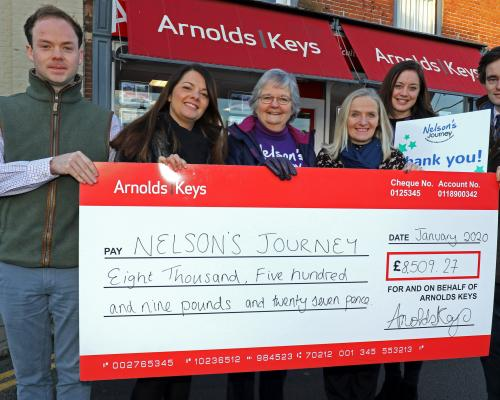 Arnolds Keys Nelsons Journey cheque presentation