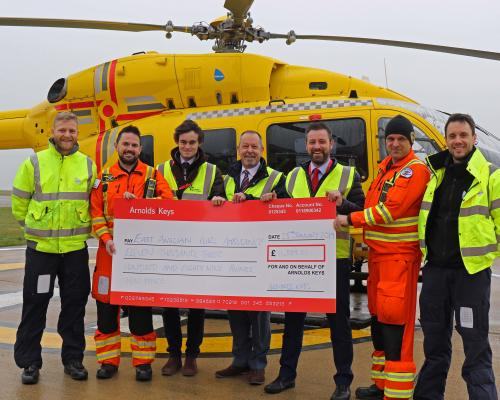 Arnolds Keys cheque presentation to East Anglian Air Ambulance sm