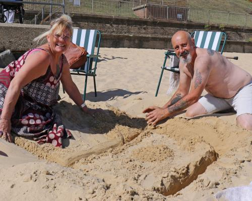 Broadland Housing Group sandcastle competition winners Angels and Brian Barnes start their creation sm
