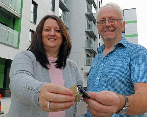 Canary Quay tenant Andrew Parfitt receives his keys from Paula Strachan of Broadland Housing Association sm