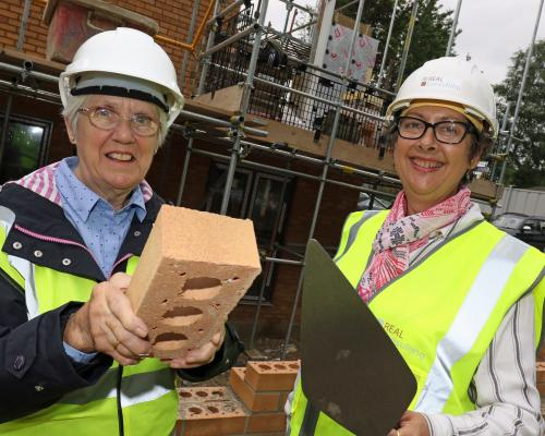 Carol Sangster left and Cllr Gail Harris lay the Golden Brick at Leander Court in Norwich 1