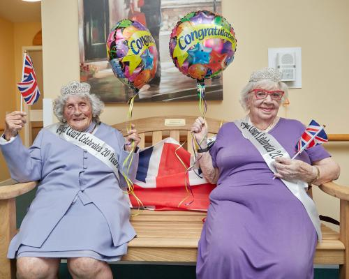 Centenarians Pattie Knopp left and Marion Bubs Wilkinson celebrate the 20th birthday of Lloyd Court sm