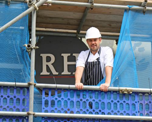 Chef Roger Hickman inspects the building work at his Norwich restaurant sm