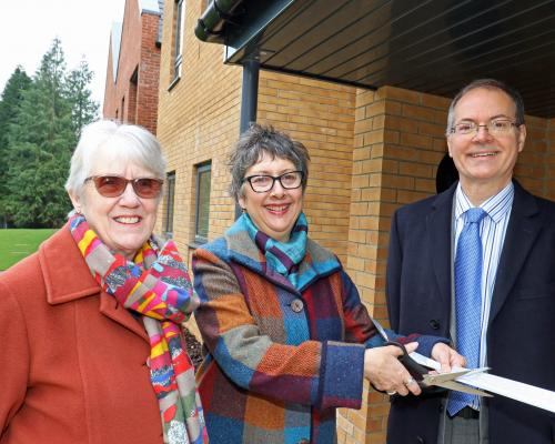 Cllr Gail Harris cuts the ribbon at Leander Court watched by Norwich Housing Society chairman Carol Sangster and chief executive Mike Allen sm