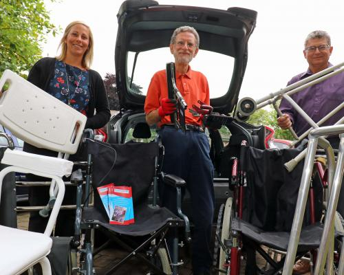 David Potten of PhysioNet centre collecting equipment from Norwich Housing Society helped by Kelly Jackson and Mark Finch sm