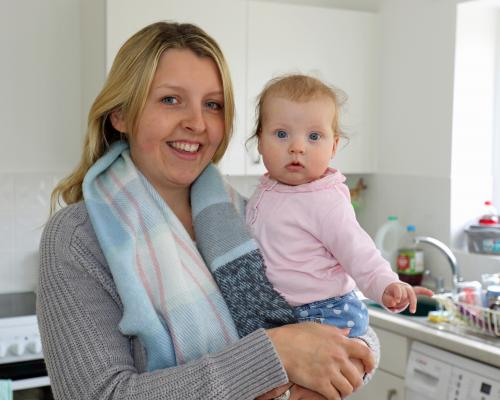 Emma Payne and baby Lily in the kitchen of their new home