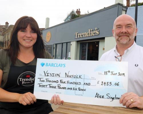 Marathon runner Alice Sizeland presents the cheque to Clive Evans of the NNAB sm