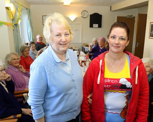 Marathon runner Marie Charles right with her mum Kathy Glanville at the fundraising coffee morning at Eleanor Road sm