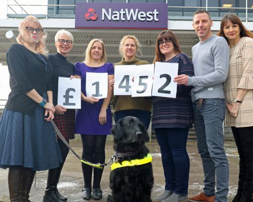 NatWest staff celebrate their fundraising effort for the NNAB sm