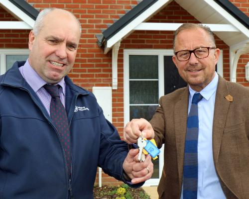 Paul PItcher right of Wellington hands over the keys to the Reydon homes to Ian Fieldhouse of Orbit sm