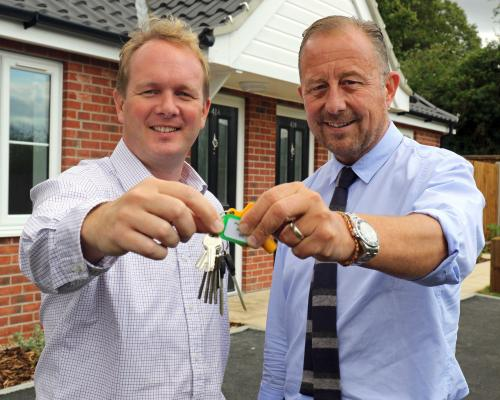 Paul Pitcher of Wellington right hands the keys over to Scott Bailey of Havebury Housing Partnership sm