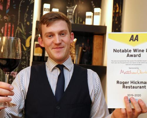 Roger Hickmans Restaurant front of house manager Ed Akister with the AA wine award sm