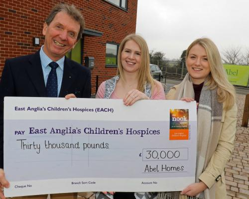 Sophie Mayes right from The Nook Appeal receives a cheque for 30000 from Tony Abel and Kim Macey of Abel Homes sm