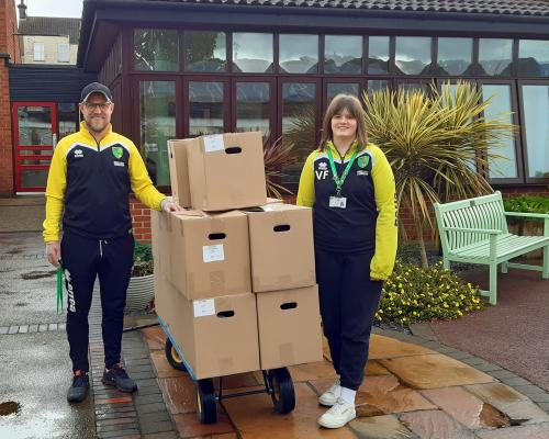 Staff from Norwich Citys Community Sports Foundation deliver food parcels to Vision Norfolks Hammond Court sheltered accommodation sm
