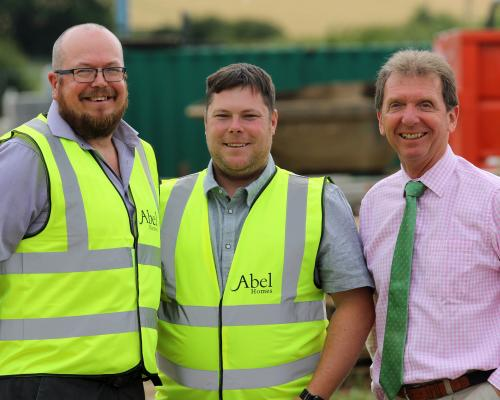 Tim Walsingham left and Danny Pinner centre with Abel Homes chairman Tony Abel sm