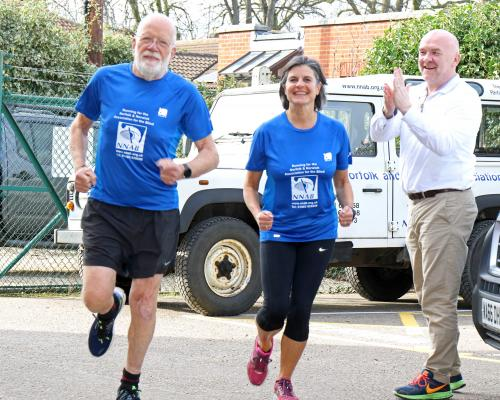 Tim and Rachel Hirst train for the London Marathon cheered on by Clive Evans of the NNAB sm
