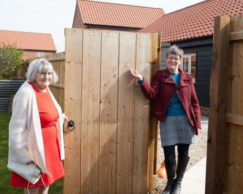 Trunch residents Gillian right and her mum Joan meet at the gate between their two homes by Broadland Housing