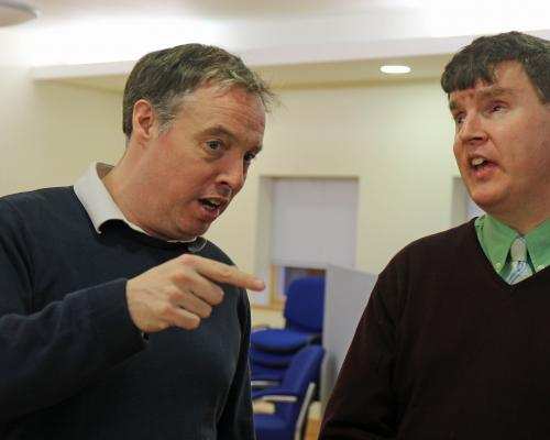 Visually Impaired Choir members Mike Wordingham and Mark Smith get to grips with the harmony at the taster session sm