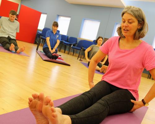 Visually impaired yoga teacher Angelique Weatherby leads a class at the NNAB sm