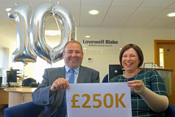 Gary Flatt and Mel Wright of Lovewell Blake celebrate the 10th anniversary of the LB150 Fund which has broken through the 250000 mark
