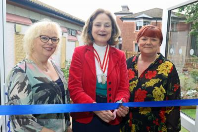 Lady Agnew cuts the ribbon to open the new sensory garden watched by Gina Dormer left and Amanda Skinner