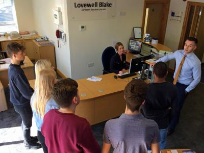 Lovewell Blake staff Vicki Harrow and Daniel Applegate welcome some of the Lowestoft College students to the firms Lowestoft office