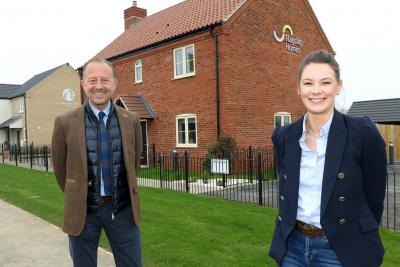 Paul Pitcher of Wellington and Charlotte Mowforth of Flagship Homes celebrate the handing over of 11 new homes at Ellingham Green