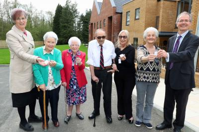 The first residents at Leander Court in Norwich receive their keys from Norwich Housing Society sm